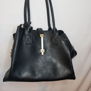 Black vegan leather bag with gold accents
